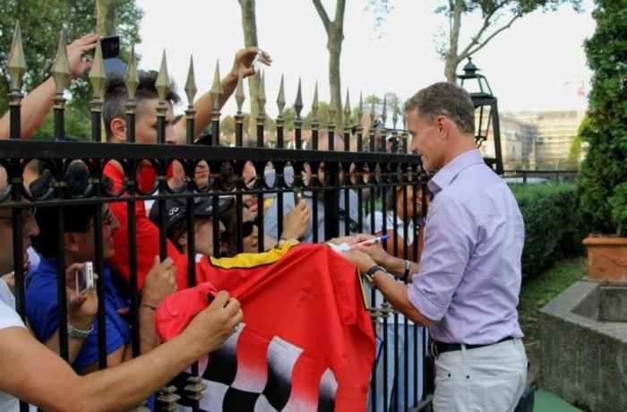 Former F1 driver David Coulthard signs autographs to fans outside Hotel de la Ville Monza